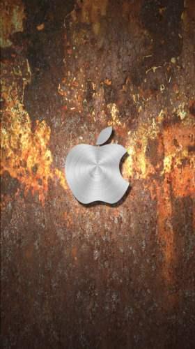 錆びたメタルに浮かぶAppleステンレス風ロゴ